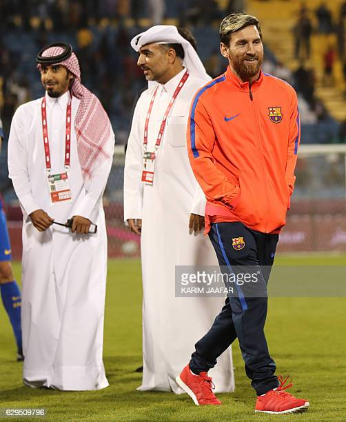 FC Barcelona's Lionel Messi receives smiles following a friendly football match between FC Barcelona and Saudi Arabia's AlAhli FC on December 13 2016...