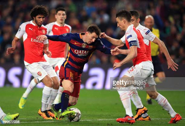 Barcelona's Lionel Messi runs at the Arsenal defence