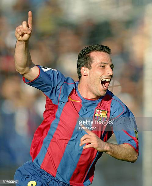 Barcelona`s Ludovic Giuly celebrates after scoring a goal during a La Liga soccer match between Malaga and Barcelona at the Rosaleda stadium on April...
