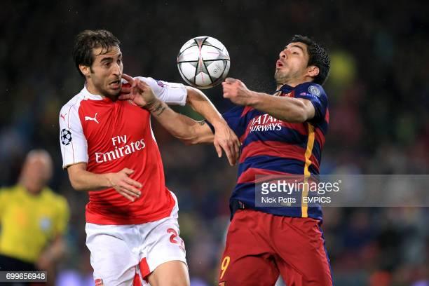 Barcelona's Luis Suarez and Arsenal's Mathieu Flamini battle for the ball