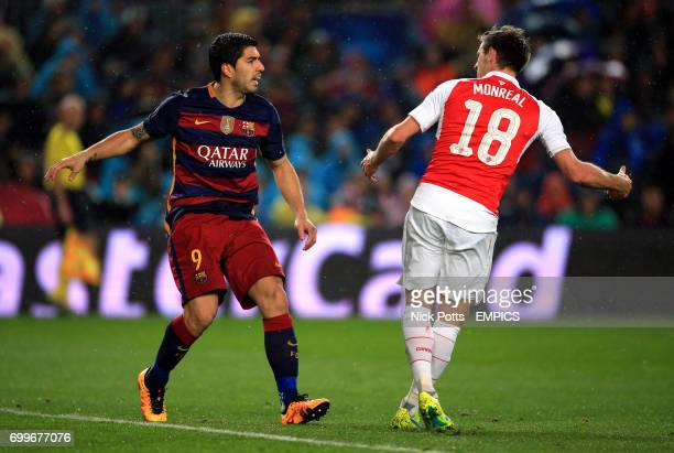 Barcelona's Luis Suarez and Arsenal's Nacho Monreal get involved in a altercation