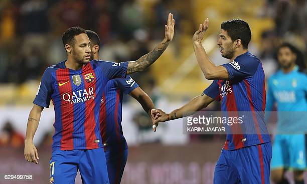 FC Barcelona's Luis Suarez and Neymar celebrate after a goal during a friendly football match between FC Barcelona and Saudi Arabia's AlAhli FC on...