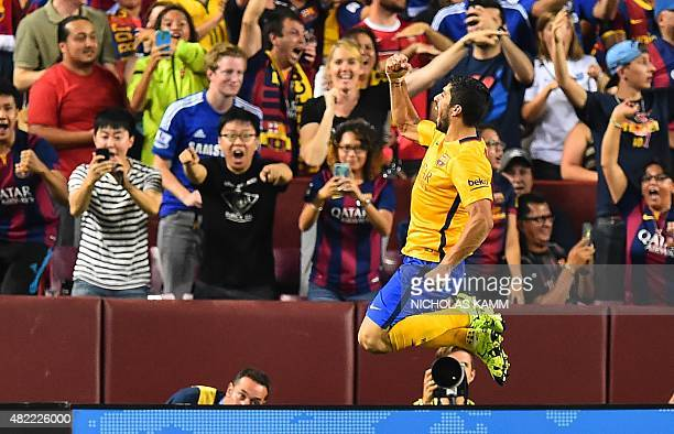 Barcelona's Luis Suarez celebrates scoring against Chelsea during an International Champions Cup football match in Landover Maryland on July 28 2015...