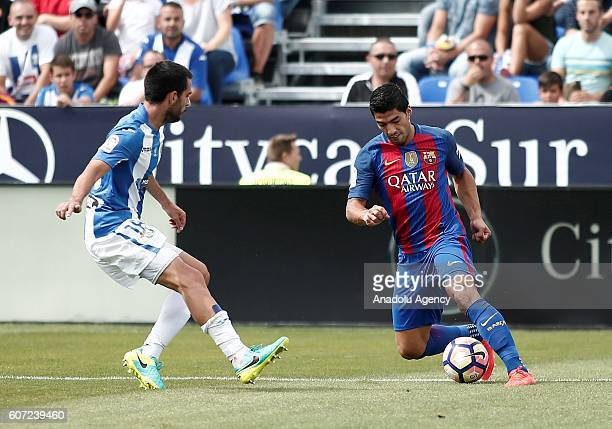 Barcelona's Luis Suarez in action against Pablo Insua of Leganes during the Spanish La Liga soccer match between FC Barcelona and Leganes at Butarque...