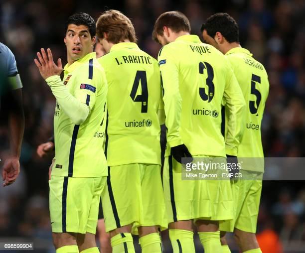 Barcelona's Luis Suarez Ivan Rakitic Gerard Pique and Sergio Busquets form a defensive wall