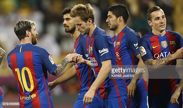 FC Barcelona's Luis Suarez Lucas Digne Linonal Messi Ivan Rakitic and André Gomes celebrate after a goal during a friendly football match between FC...