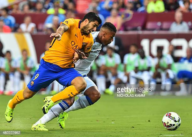 Barcelona's Luis Suarez vies with Chelsea's Kenedy during an International Champions Cup football match in Landover Maryland on July 28 2015 AFP...