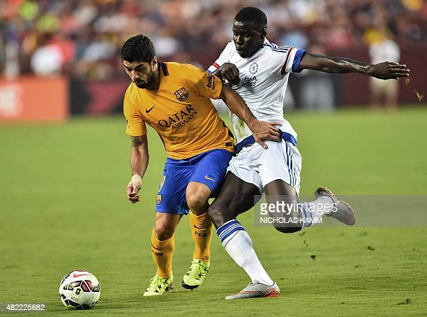 Barcelona's Luis Suarez vies with Chelsea's Kurt Zouma during an International Champions Cup football match in Landover Maryland on July 28 2015 AFP...
