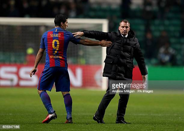 Barcelona's Luis Suarez with Celtic manager Brendan Rodgers after the final whistle during the UEFA Champions League match at Celtic Park Glasgow