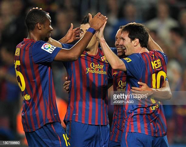 Barcelona's Malian midfielder Seydou Keita Barcelona's forward David Villa Barcelona's Brazilian defender Adriano and Barcelona's Argentinian forward...