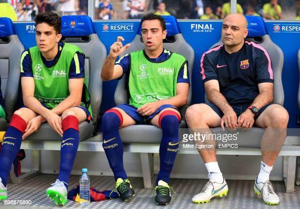 Barcelona's Marc Bartra Xavi Hernandez and goalkeeper coach Jose Ramon de la Fuente