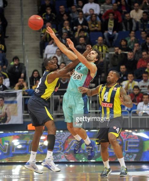 Barcelona's Marcelinho Huertas vies with Fenerbahce's Romain Sato and Bo Mccalebb during the Euroleague basketball match Fenerbahce vs Barcelona on...
