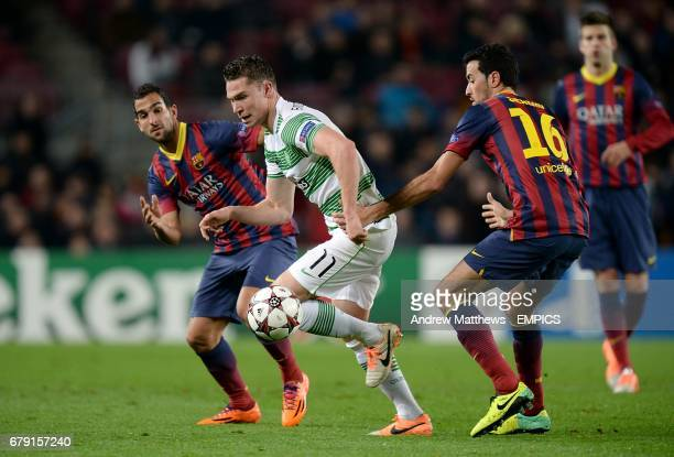 Barcelona's Martin Montoya and Sergio Busquets battle for the ball with Celtic's Derk Boerrigter