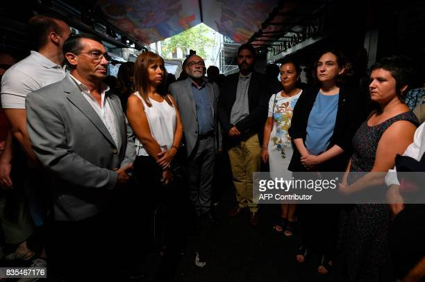 Barcelona's mayor Ada Colau and officials observe a minute of silence with the lights off inside of La Boqueria market in Barcelona to pay tribute to...