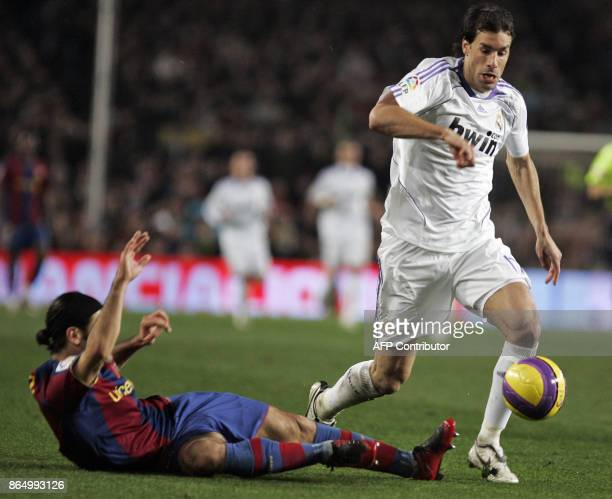 Barcelona's Mexican Marquez vies for the ball with Madrid's Dutch Van Nistelrooy during their first league football match Barcelona vs Madrid at the...