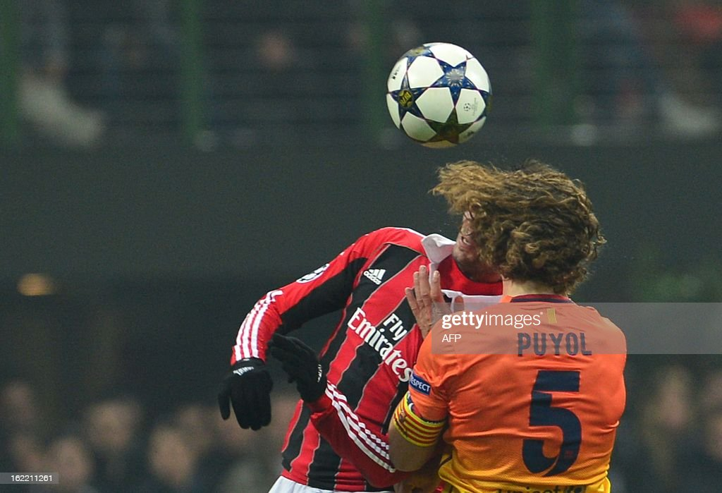 Barcelona's midfielder and captain Carles Puyol challanges for the ball with AC Milan's forward Giampaolo Pazzini during the Champions League football match between AC Milan and FC Barcelona on February 20, 2013 at San Siro Stadium in Milan. AFP PHOTO / GIUSEPPE CACACE