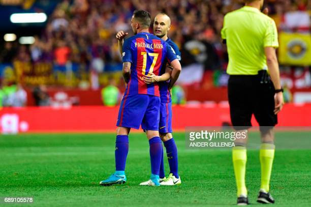 Barcelona's midfielder Andres Iniesta and Barcelona's forward Paco Alcacer celebrate after the team won the Spanish Copa del Rey final football match...