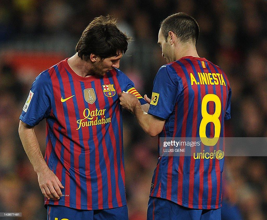 Barcelona s midfielder Andres Iniesta R