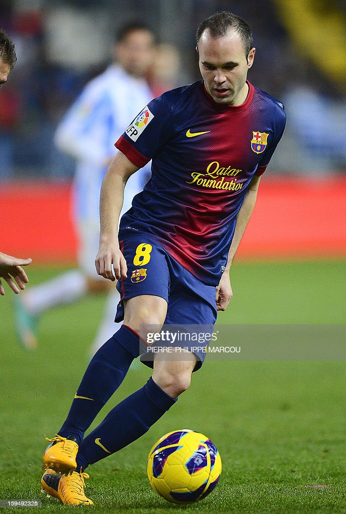 Barcelona's midfielder Andres Iniesta kicks the ball during the Spanish league football match Malaga vs Barcelona at la Rosaleda stadium in Malaga on January 13, 2013.