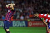 Barcelona's midfielder Andres Iniesta reacts during the Spanish league football match Granada CF vs FC Barcelona at the Nuevo Los Carmenes stadium in...
