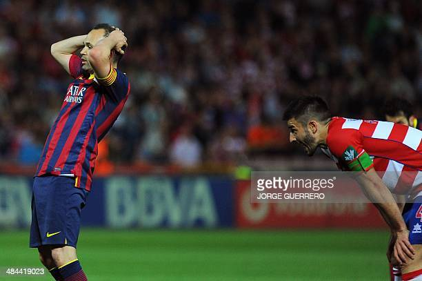 Barcelona's midfielder Andres Iniesta reacts during the Spanish league football match Granada CF vs FC Barcelona at the Nuevo Los Carmenes stadium in...