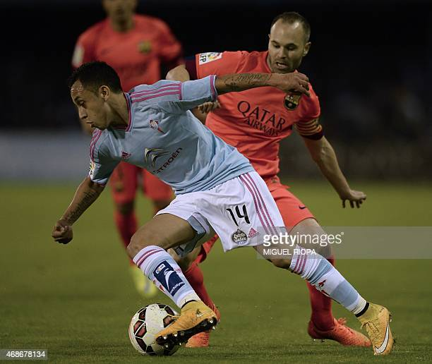 Barcelona's midfielder Andres Iniesta vies with Celta's Chilean forward Fabian Orellana during the Spanish league football match RC Celta de Vigo vs...