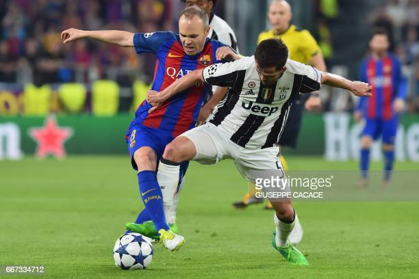 Barcelona's midfielder Andres Iniesta vies with Juventus midfielder Miralem Pjanic during the UEFA Champions League quarter final first leg football...
