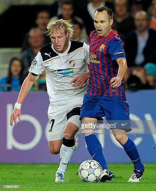 Barcelona's midfielder Andres Iniesta vies with Viktoria Plzen's Czech Republic midfielder Frantisek Rajtoral during their Champions League football...