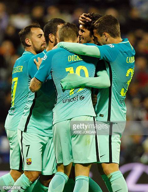 Barcelona's midfielder Carles Alena celebrates with teammates after scoring the equalizer during the Spanish Copa del Rey round of 32 first leg...