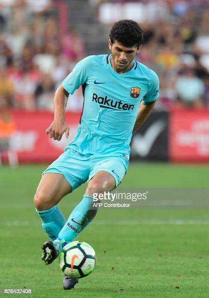 Barcelona's midfielder Carles Alena controls the ball during the friendly football match between Club Gimnastic de Tarragona SAD and FC Barcelona at...