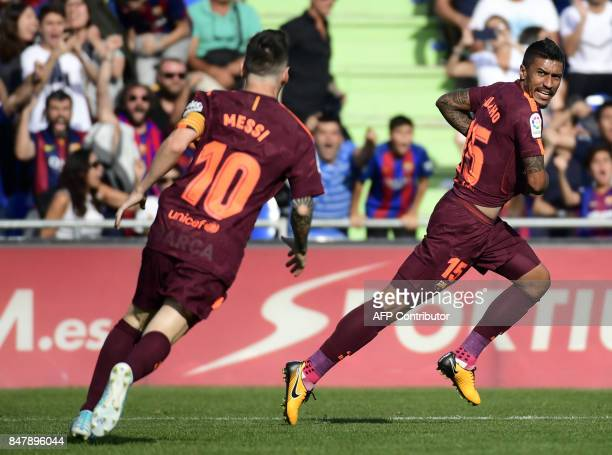 Barcelona's midfielder from Brazil Paulinho celebrates a goal during the Spanish league football match Getafe CF vs FC Barcelona at the Col Alfonso...