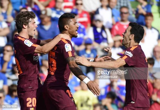 Barcelona's midfielder from Brazil Paulinho celebrates a goal with Barcelona's midfielder from Spain Sergi Roberto and Barcelona's midfielder from...
