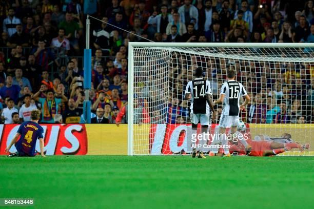 Barcelona's midfielder from Croatia Ivan Rakitic scores their second goal during the UEFA Champions League Group D football match FC Barcelona vs...