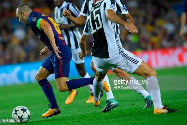 Barcelona's midfielder from Spain Andres Iniesta vies with Juventus' defender from Italy Andrea Barzagli during the UEFA Champions League Group D...
