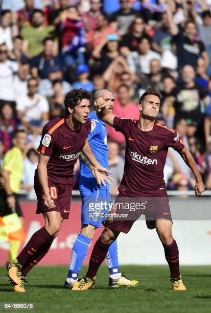 Barcelona's midfielder from Spain Denis Suarez celebrates a goal with Barcelona's midfielder from Spain Sergi Roberto during the Spanish league...
