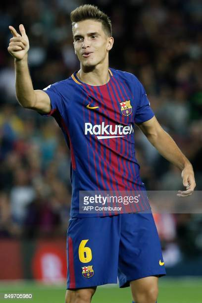 Barcelona's midfielder from Spain Denis Suarez celebrates after scoring during the Spanish league football match FC Barcelona against SD Eibar at the...