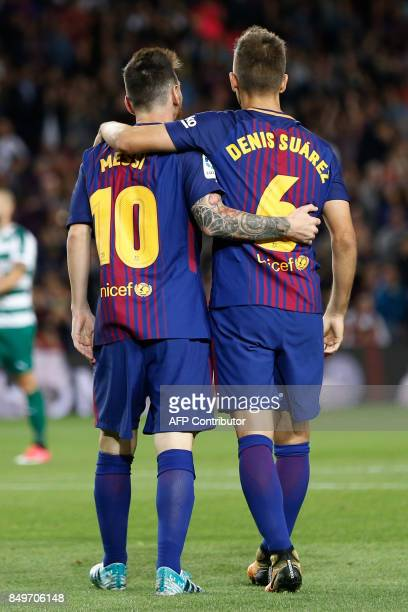 Barcelona's midfielder from Spain Denis Suarez celebrates with Barcelona's forward from Argentina Lionel Messi after scoring during the Spanish...