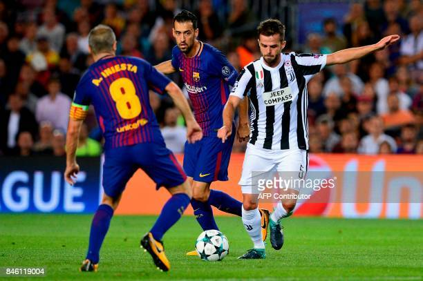 Barcelona's midfielder from Spain Sergio Busquets vies with Juventus' midfielder from BosniaHerzegovina Miralem Pjanic during the UEFA Champions...