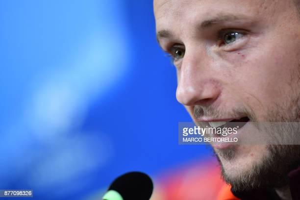 Barcelona's midfielder Ivan Rakitic from Croatia attends a press conference on the eve of the UEFA Champions League football match Juventus Vs...