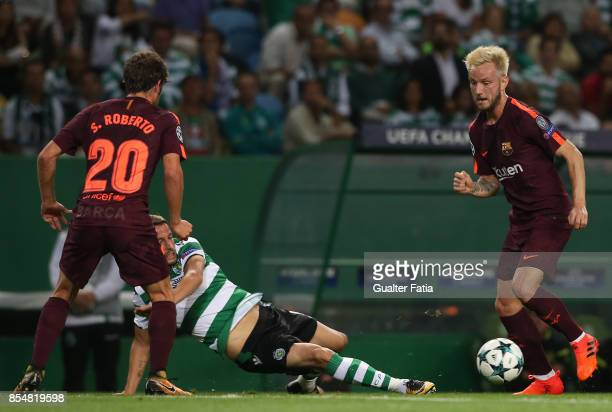 Barcelona's midfielder Ivan Rakitic from Croatia with Sporting CP defender Fabio Coentrao from Portugal in action during the UEFA Champions League...