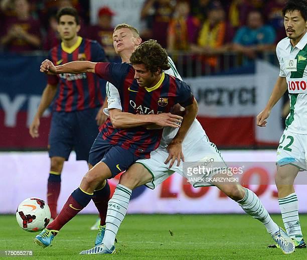 FC Barcelona's midfielder Sergi Roberto Carnicer and Lechia Gdansk's midfielder Pawel Dawidowicz vie for the ball during their preseason friendly...