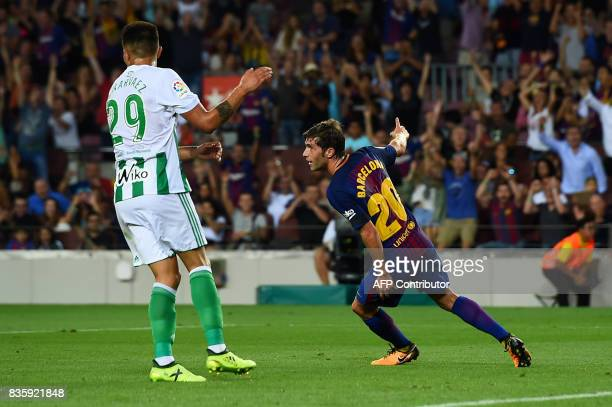 Barcelona's midfielder Sergi Roberto celebrates after scoring during the Spanish league footbal match FC Barcelona vs Real Betis at the Camp Nou...