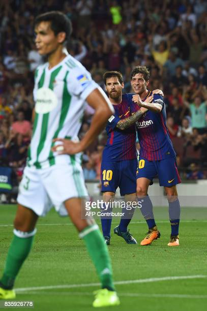 Barcelona's midfielder Sergi Roberto celebrates with Barcelona's Argentinian forward Lionel Messi after scoring during the Spanish league footbal...
