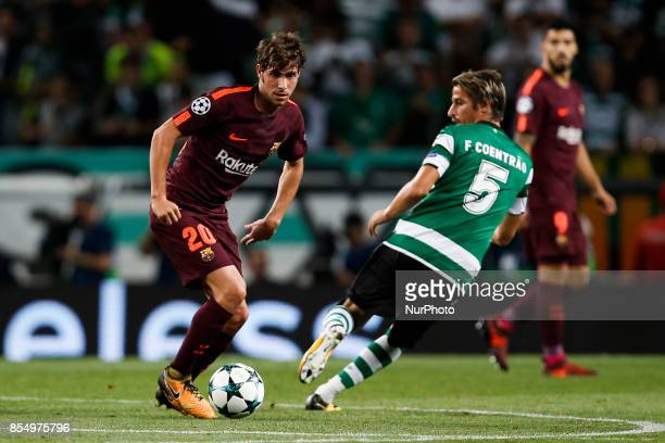 Barcelona's midfielder Sergi Roberto vies for the ball with Sporting's defender Fabio Coentrao during the Champions League 2017/18 match between...