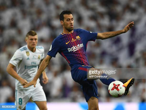 Barcelona's midfielder Sergio Busquets controls thje ball during the second leg of the Spanish Supercup football match Real Madrid vs FC Barcelona at...