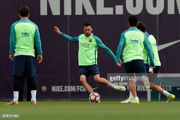 Barcelona's midfielder Sergio Busquets kicks a ball during a training session at the Sports Center FC Barcelona Joan Gamper in Sant Joan Despi near...