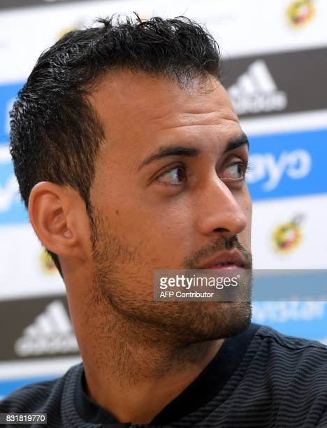 Barcelona's midfielder Sergio Busquets looks on during a press conference at the Sports Center FC Barcelona Joan Gamper in Sant Joan Despi near...