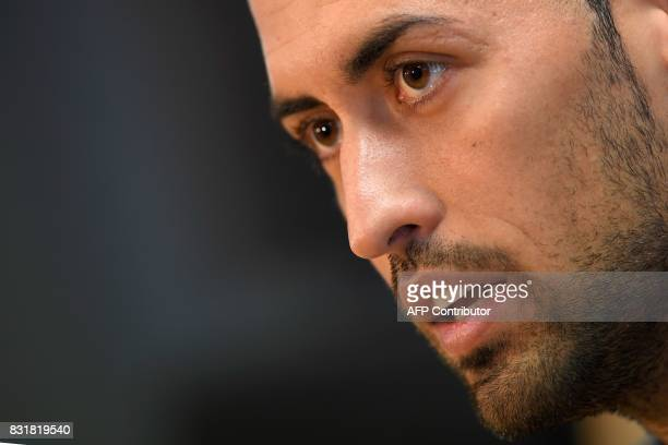Barcelona's midfielder Sergio Busquets speaks during a press conference at the Sports Center FC Barcelona Joan Gamper in Sant Joan Despi near...