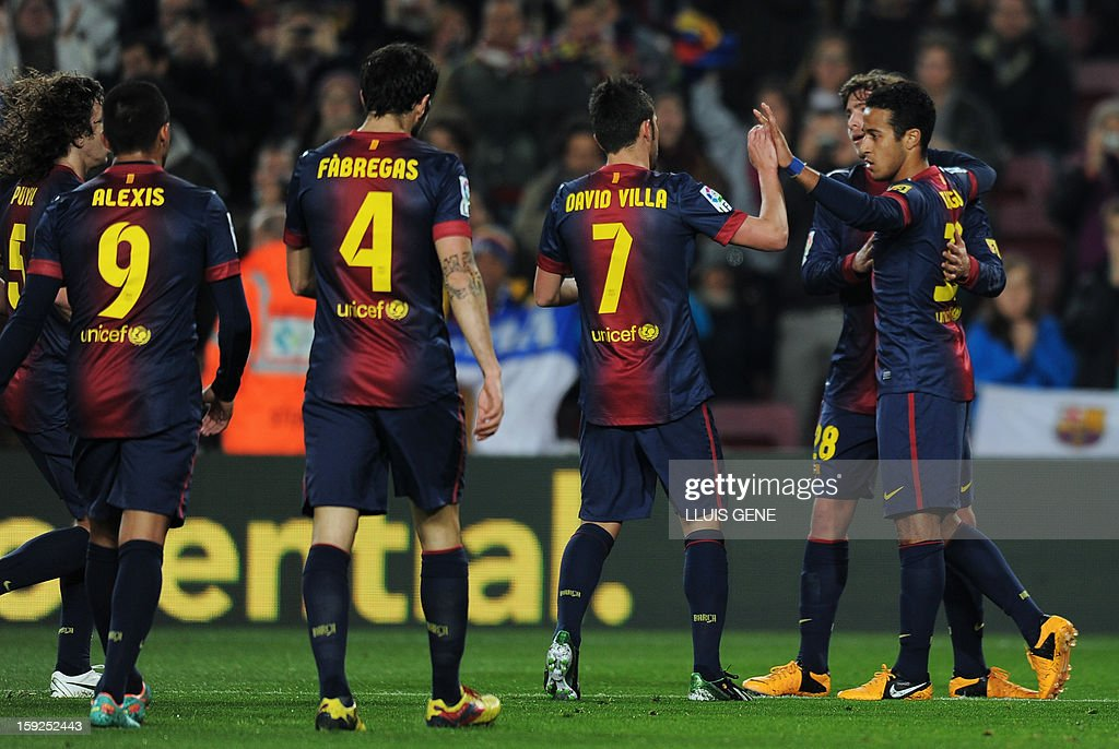 Barcelona's midfielder Thiago Alcantara (R) celebrates with his teammates after scoring during the Spanish Copa del Rey (King's Cup) football match FC Barcelona vs Cordoba CF at the Camp Nou stadium in Barcelona on January 10, 2013.