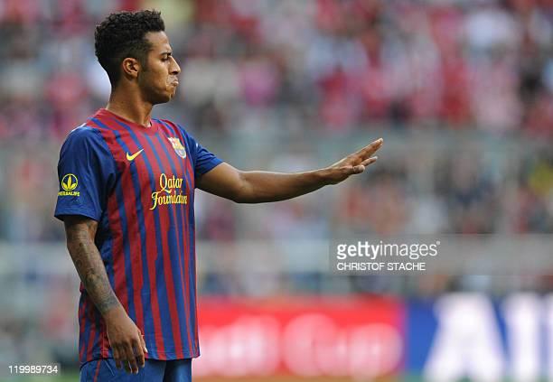 Barcelona's midfielder Thiago Alcantara gestures during their Audi Cup football match FC Barcelona vs SC International de Porto Alegre in Munich...